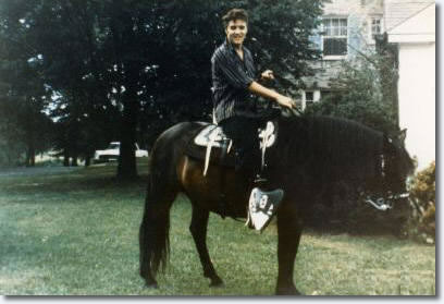 "Elvis Presley at Graceland in the 1950's. ""The King of Rock n' Roll"" loved horses so much he purchased a ranch in Mississippi, the Circle-G, house the many horses he gifted to his friends./Photo credit: elvispresleymusic.com au"