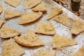 Parmesan pita triangles are a delicious alternative to chips./Photo credit: oneshetwoshe.com