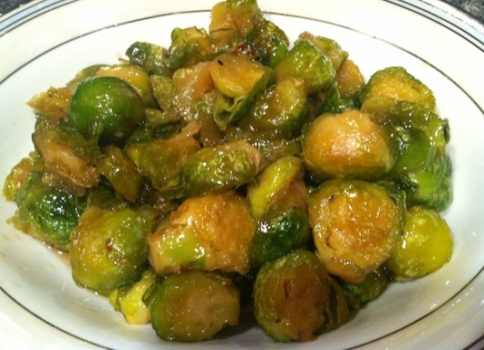 Maple Syrup Roasted Brussels Sprouts is a simple and delicious side dish for any meal. The maple syrup not only mellows the slight bitterness of the Brussels sprouts, it's an incredible antioxidant filled with nutrients like zinc, iron, calcium and potassium./Photo credit: Lisa Singer