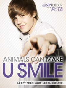"""Justin Bieber Adopt Ad: Justin Bieber stars in an ad for PETA featuring the tagline, """"Animals Can Make U Smile. Adopt From Your Local Shelter."""" Photo Credit: PETA"""