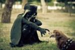 boy dressed as darth vader with chewbacca dachshund dog