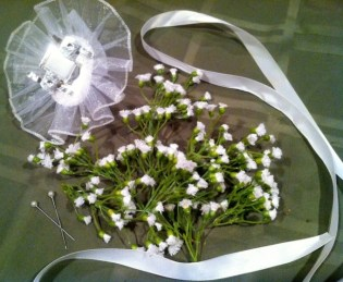 Baby's breath, satin ribbon, pearl pins and a lace wristlet are all you'll need to make your own homemade corsage./Photo credit: Lisa Singer