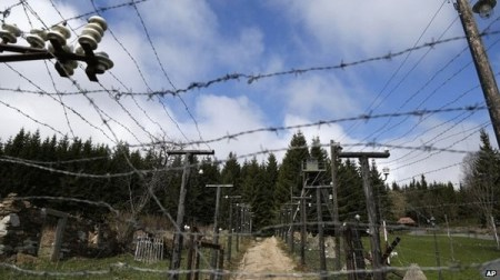 This reconstruction in the Sumava National Park in the Czech Republic shows the Iron Curtain's electrified fence. Photo Credit: AP