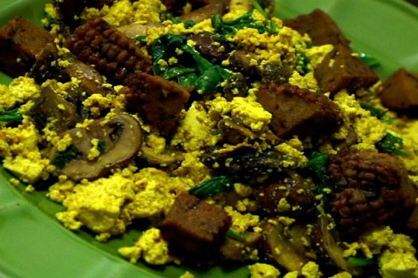 (VEGAN/VEGETARIAN RECIPES) This hearty tofu scramble has vegan sausage and mushrooms.