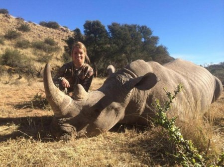 Kendall Jones poses next to a rhino she killed. Photo Credit: Facebook