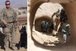 Deployed U.S. solider Ryan Henderson with his military bomb sniffing dog Satan