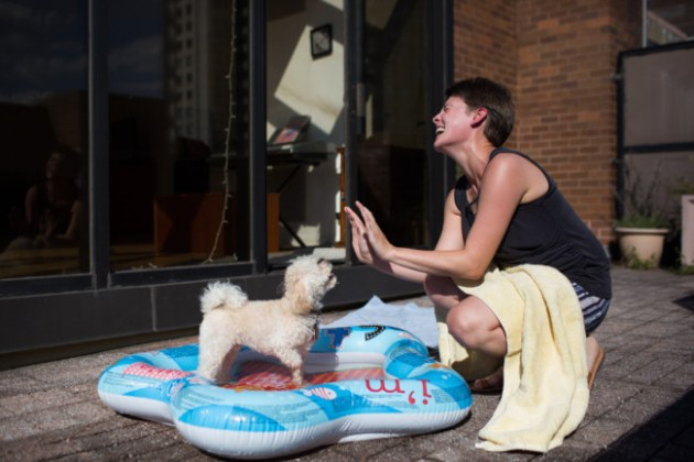 Lindsay Wilczynski played with her dog, Indiana, in Manhattan in July. Photo Credit: Kevin Hagen via The New York Times