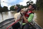 Mark Buchert from the Louisiana State Animal Response Team gets a lick from a dog he helped rescue from flood waters