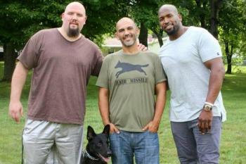 Former NFL player Brian Schaefering, service dog Niklaus, Richard Starks, and Baltimore Ravens Eugene Monroe. Photo Credit: Jas Schaefering Photography