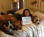 girl-poses-with-pit-bull-dogs-and-note-card-confession