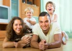 Happy family with pet cat