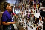 Woman co-founder of animal advocacy group Desmond's Army looks at photos of rescued animals