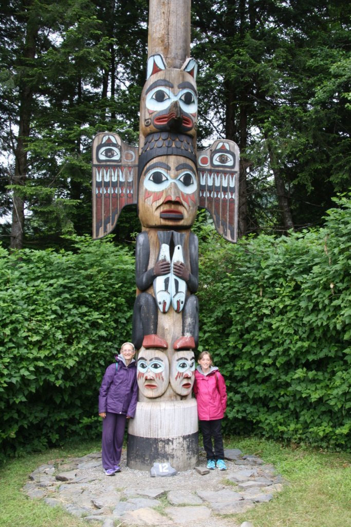 Posing with one of the totem poles