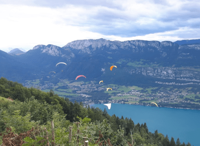 Paragliders over Lake Annecy