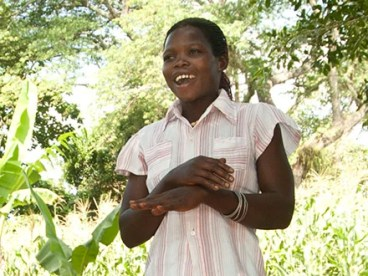 Beneficiary of women's agriculture project in Uganda speaks to her community