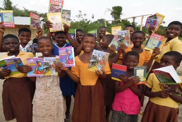 group of teen girls poses happily with their new books