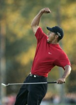2005 Masters – Woods shot 12 under and beat Chris DiMarco in a playoff, but the tournament will be remembered for one shot: Tiger's miraculous chip-in on No. 16 in the final round. (Photo: Shaun Best JLS/SV/Reuters)
