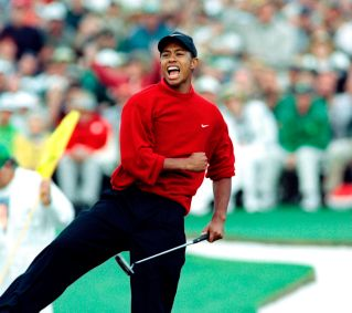1997 Masters – Woods shot 18-under par to win by 12 strokes. His most dominating performance at Augusta was a loud announcement that the golf world was about to change. He became the youngest winner of a major at 21 years, 3 months and 14 days old. It was the largest margin of victory in Masters history. (Photo: Timothy A. Clary, AFP/Getty Images)
