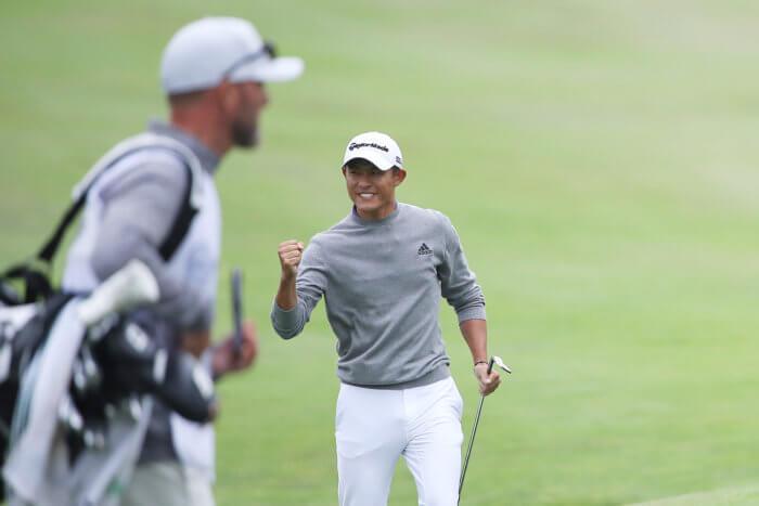 Colin Morikawa celebrates 14th hole chip-in