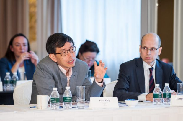 Peter Ong (left) shares his thoughts with Martti Hetemäki, permanent secretary, Ministry of Finance, Finland (right) and heads of financial ministries from 12 further countries around the world, at the Global Government Summit 2015