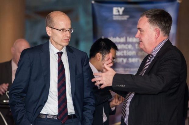 Iain Rennie discusses government finance initiatives with Head of the Finnish Ministry of Finance, Martti Hetemäki, at the Global Government Finance Summit