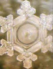 A structured water molecule after treatment with positive intent phrase 'Thank You' placed on glass container of water. From 'The Message From Water' by Masaru Emoto.