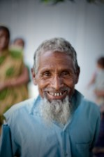 An old Bangladeshi man smiles for a photograph - Paul Joseph Brown Global Health Photography - Public Health Photography
