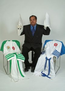 Daryl Davis with Klan robes given to him by friends who left the KKK