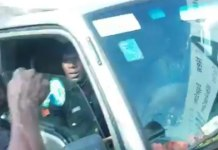 Video Of How A policeman was ordered out of a man's truck by a group of Nigerians for allegedly trying to extort the driver