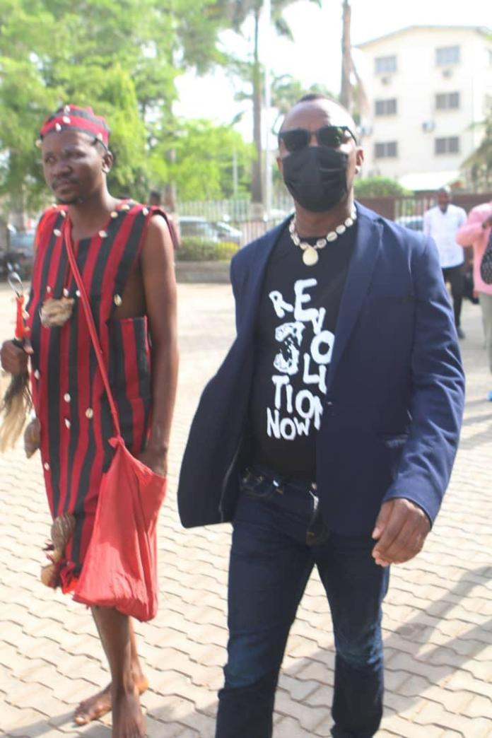 Photos Of Man Wearing Juju Dress And Follows Sowore To Court