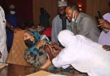 Scared Look Photo Of Niger State Commissioner Rahamatu Yar'adua As She Recieves COVID-19 Vaccine