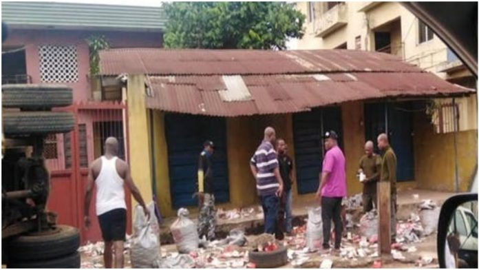 A Loaded Truck Falls In Onitsha And Spills Live Bullets