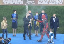 Russian footballer Artem Dzyuba wearing the Deadpool costume to receive League winner's medal