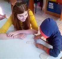 Volunteering helping with arts and crafts at Peru Community Project