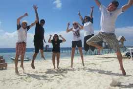 Volunteer Group on Beach in Borneo