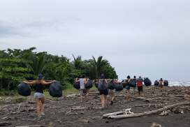 Volunteers in Malaysia cleaning up beaches