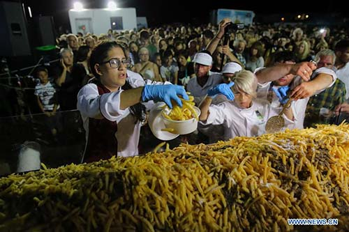 Image result for Greek 'potato island' breaks Guinness World Record for biggest batch of fries