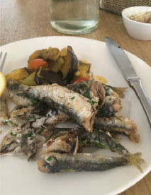 FISHY The headless sardines served as Plan C for one of Gregg Buchbinder's lunches in Brera.