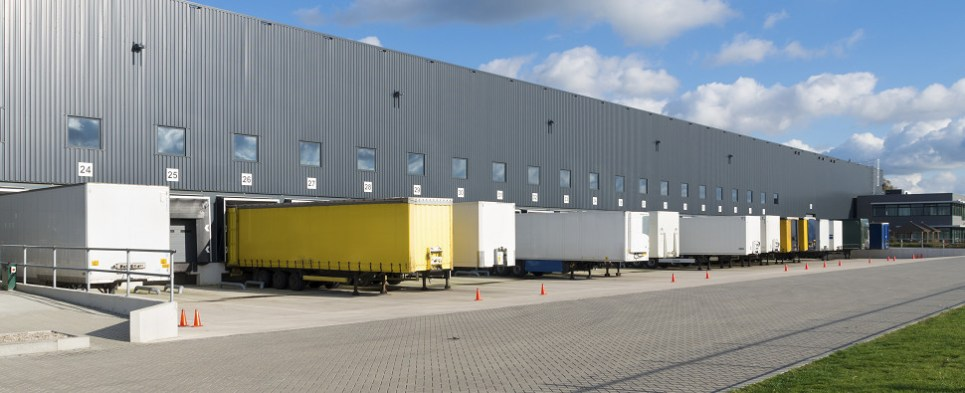 Big-box warehouses distribute shipments of export cargo and import cargo in international trade.