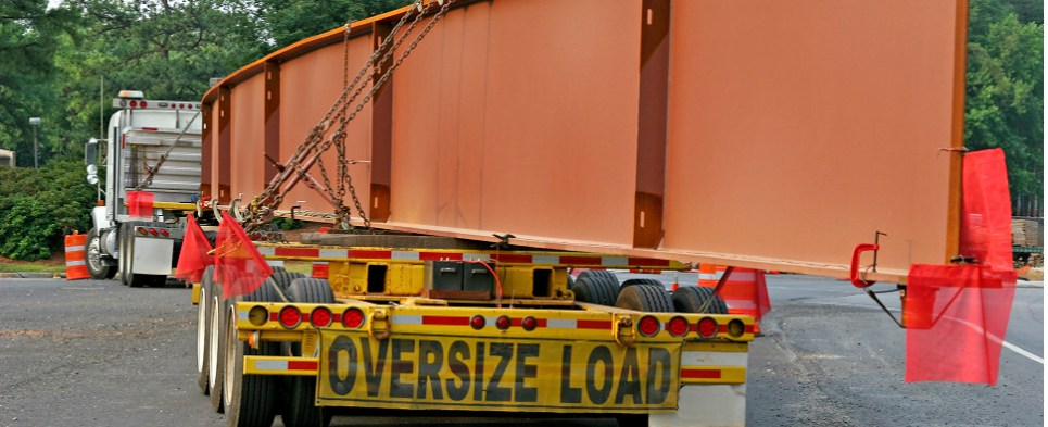 New software for heavy haul trucking shipments of export cargo and import cargo in international trade.