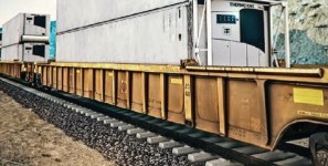 Containers carry refrigerated shipments of export cargo and import cargo in international trade.