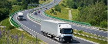 reducing truck emissions that crry shipments of export cargo and import cargo in international trade.