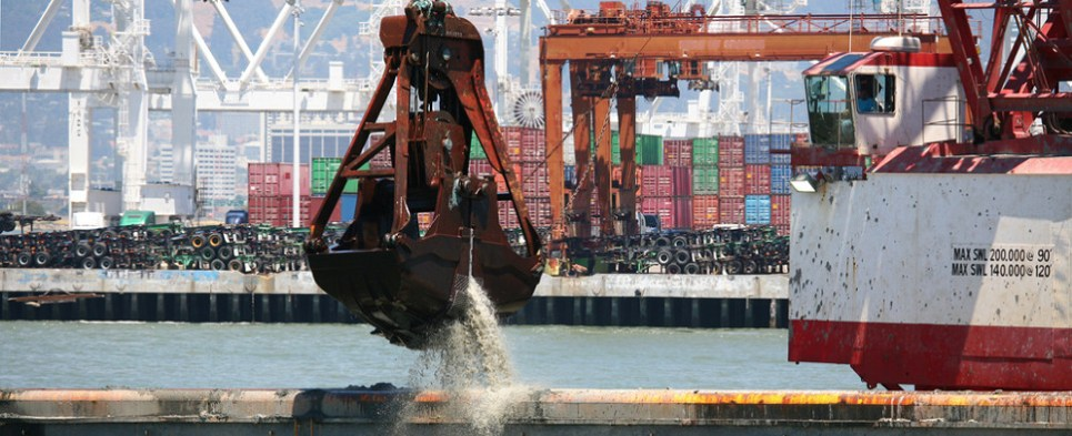 Dredging allows ports to handle more shipments of export cargo and import cargo in international trade.
