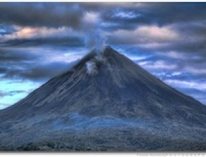 The amount of greenhouse gases emitted by even a large and ongoing volcanic eruption is miniscule compared to industrial and automotive carbon emissions caused by human activity. Global warming can, however, help trigger volcanic eruptions by melting the ice that keeps rock from turning to magma. Pictured: The Arenal Volcano in Costa Rica, one of the 10 most active volcanoes in the world