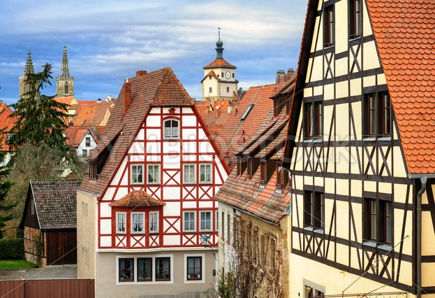 traditional red tile roofs and half timbered houses in rothenburg ob der tauber germany