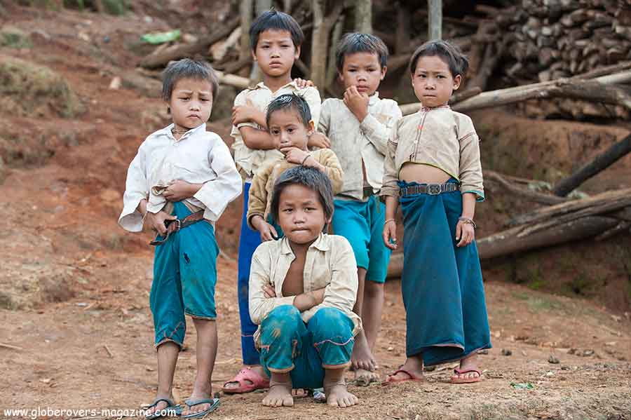 People in hut at Pang Pack, a Lahu-shi village, west of Keng Tung, Shan State, Myanmar
