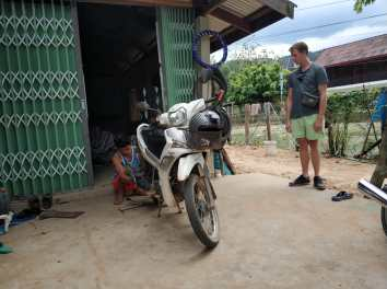 Fixing a flat tyre in Thakhek