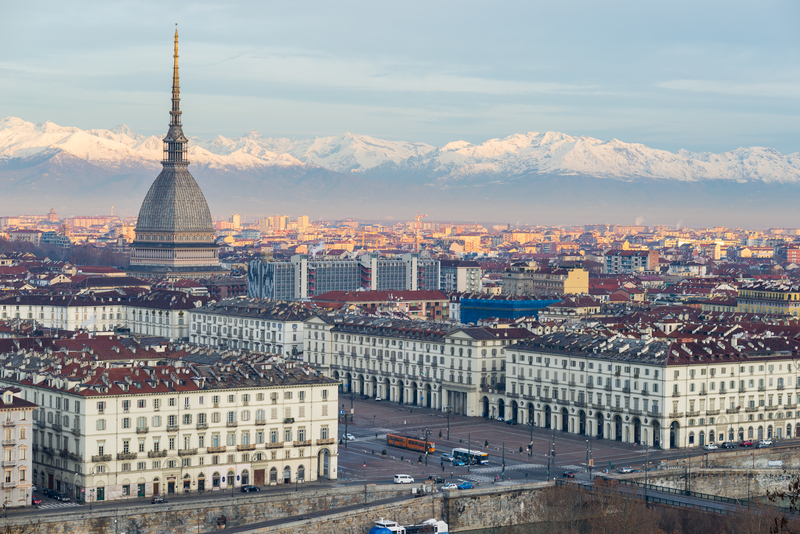 Torino Turin, Italy: cityscape at sunrise with Mole Antonelliana towering over the city.