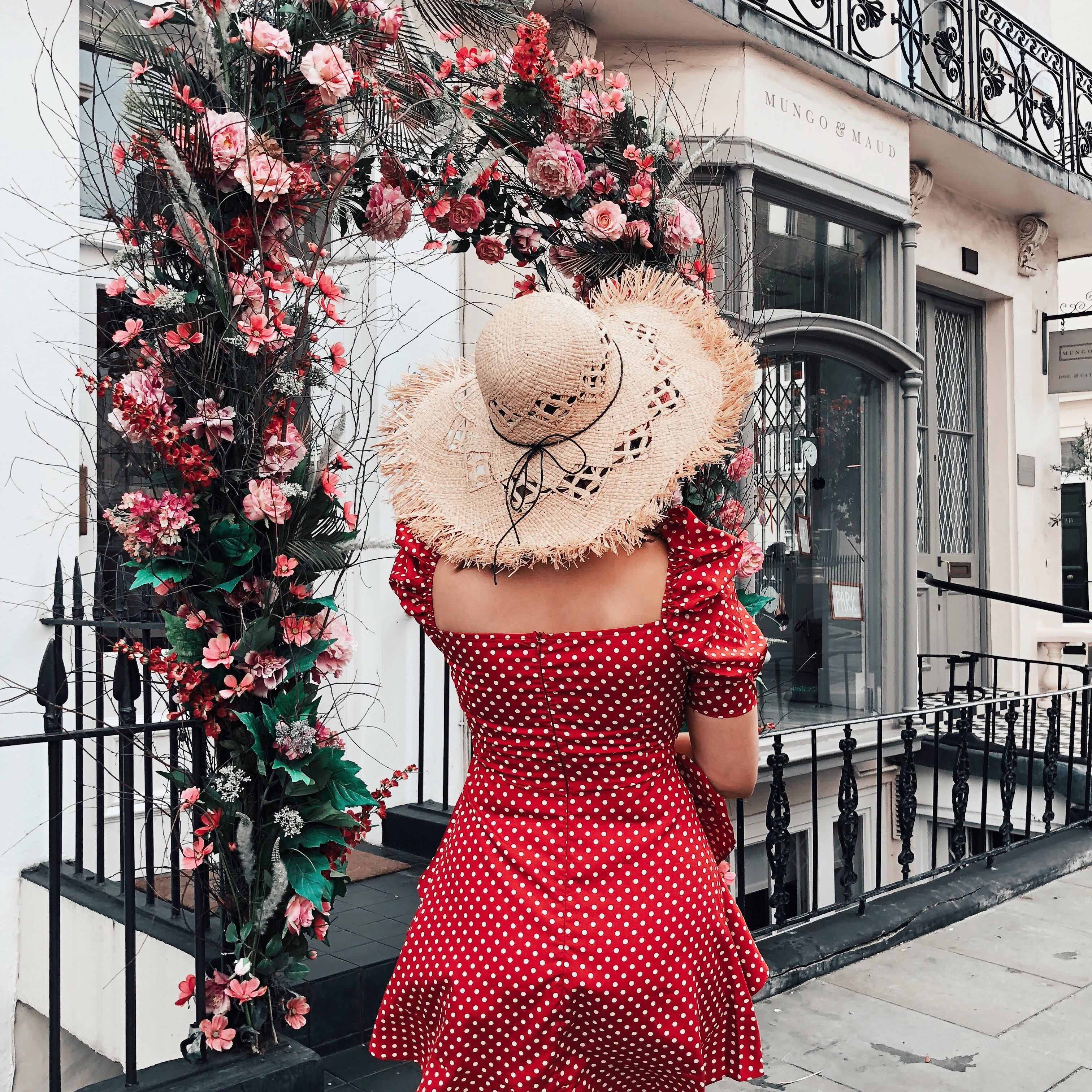 UK STAYCATION IDEAS: red mini dress and straw hat