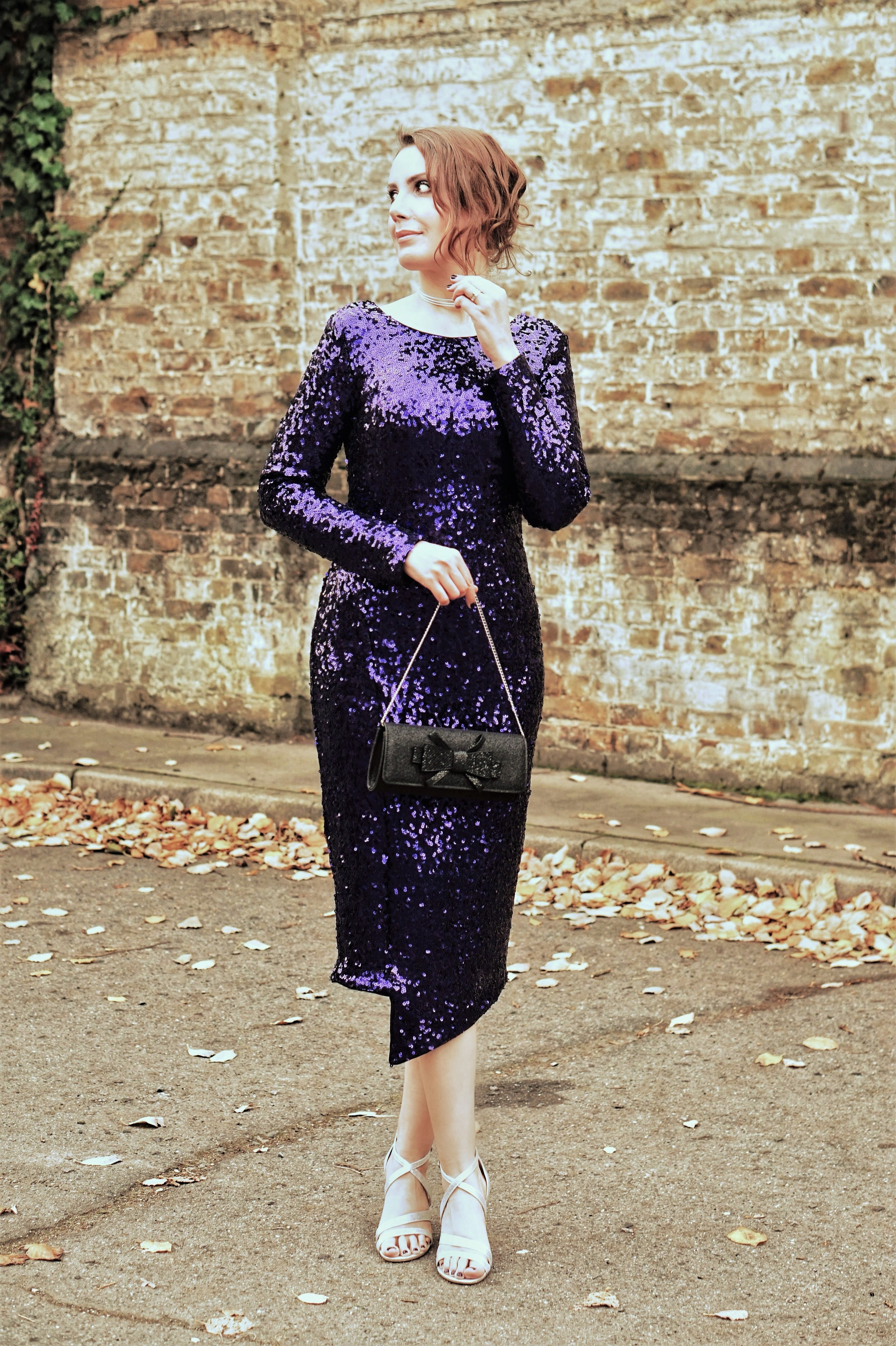 How To Find Your Perfect Party Dress - Style inspiration: purple sequin long sleeve midi length party dress, silver shoes, leaf ear climber, clutch bag.